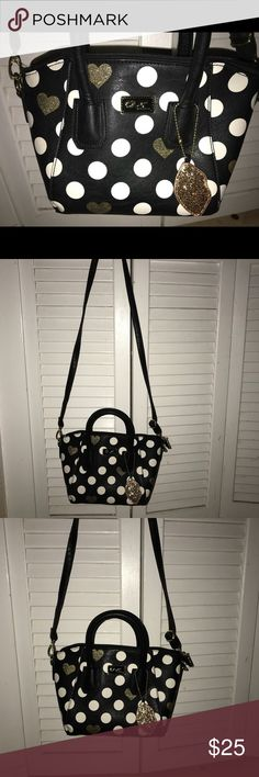 Betsy Johnson mini satchel Mini satchel with handles and crossbody strap. Black with white polka dots and gold accents.  Excellent condition. Used once.  12L x 7 1/2H Betsey Johnson Bags Mini Bags