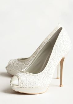 "Damn these are cute! Too bad they cost about as much as the dresses we're looking at :P    Together Forever Heels 129.99     Delicate ivory lace is paired with glowing cream colored satin to create an irresistibly romantic look on these vintage-inspired peep toe heels. European sizes.  Man-made upper, Leather lining, 5"" heel, 1"" platform"