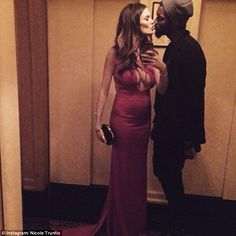 Yummy mummy! Nicole Trunfio looked terrific one month after giving birth as she sported an elegant-yet-daring keyholed red dress for a date night with Gary Clark Jr.