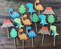 Dozen Dinosaur Themed Cupcake Picks- First Birthday, Party Decorations Dozen Dinosaur Themed Cupcake Picks- First Birthday, Party Decorations - 12 Dinosaur Cupcake Toppers Dinosaur Party Decor T-Rex First Birthday Party Decorations, First Birthday Parties, First Birthdays, Cupcake Decorations, Dinosaur Party Decorations, Dinosaur First Birthday, 1st Boy Birthday, Dinosaur Cupcake Toppers, Dinosaur Cake
