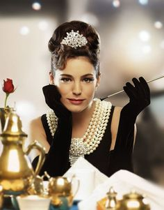 Kelly Brook recreating the famous scene from Breakfast At Tiffany's.