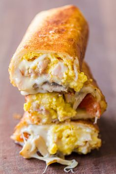 These Breakfast Burritos will make a breakfast person out of you. Crisp on the outside and filled with egg, ham and cheese. Frozen Breakfast, How To Make Breakfast, Breakfast Dishes, Breakfast Recipes, Breakfast Ideas, Brunch Ideas, Breakfast Wraps, Breakfast Sandwiches, Breakfast Club