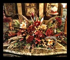 Feathered floral arrangement! We visited some great stores today and I am full of inspiration!