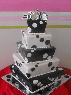Original, cute, and creative cake design featuring polka dots in black and white