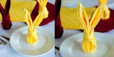 Hur du viker en servett i påsk i form av en kanin.