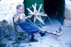 Basque Slide Show: Sheep raising is important. The wool is collected each spring. A woman spinning wool