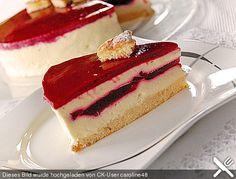 Weiße Schokoladenmousse - Torte mit Himbeerfüllung