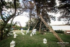 An intimate garden ceremony in villa with an unusual arch.