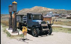 Bodie California , A 1927 Dodge Graham still stands waiting at the Shell gas station in Bodie , an abandoned mining town east of the Sierra Nevada Mountains in California . What remains of the town look's much as it did during prosperous times . The buildings are still stocked with furniture and goods . Legend has it that those that steal artifacts from the town are cursed with bad luck .