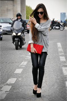 Oversized sweater, leather, and red clutch. Very cute.
