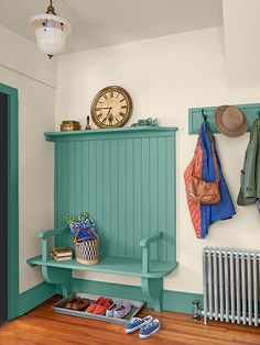 A corner of a multi-purpose room with backyard access can become an inviting spot to pause for a change of footwear. Here, a shelf-style bench that's open below shows off decorative brackets, which echo corbels in adjacent rooms. It also allows for an old-fashioned boot tray.