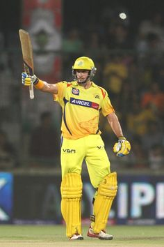 Michael Hussey of Chennai Super Kings raises his bat after reaching his fifty during the qualifier 1 match of the 2013 Pepsi Indian Premier League between The Chennai Superkings and the Mumbai Indians..