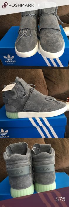 NIB NWT Adidas tubular invader strap These are great sneakers. brand new in box with tags. Color is onix/ice green. It's a grey and cool green color tubular invader straps by Adidas. I love these shoes but they run big. Would be a better fit for size 8.5 or 9 women's. Never worn. Put them on, knew they wouldn't work and listed. Adidas Shoes Athletic Shoes