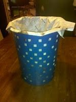 newspaper trash bag...no more plastic