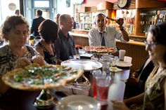 President Barack Obama Shares A Pizza Dinner With Individuals Who Wrote Letters To Him, At The Wazee Supper Club In Denver, Colo