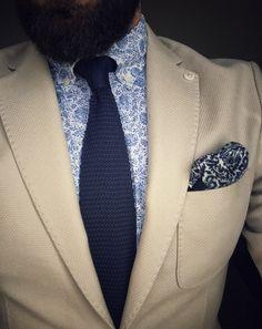 Beige blazer,navy tie...