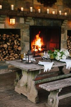 table in front of a roaring fire