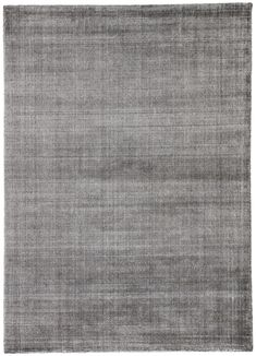 An assortment of solids with a textured update, the Paltrow collection offers a unique hand-loomed tencel construction to the modern home. Striations in the lustrous charcoal gray hue creates visual depth on the sleek Kismet area rug.