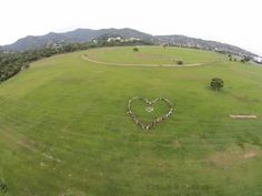 Participants of the #PeoplesClimate march in Trinidad and Tobago form the shape of a heart in the Queen's Park Savannah in Port of Spain. Photo by Nico Kersting, courtesy IAMovement, used with permission.