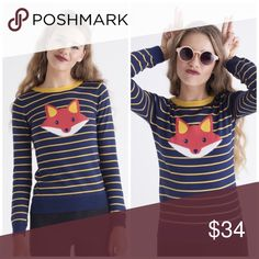 "Foxy Striped Sweater Not only are foxes sly, but they look great in stripes. This navy blue and yellow striped sweater features an adorable red fox on the front. Wear it with a pair of dark jeans and flats for a casual day look.  Materials: 55% Cotton, 45% Acrylic Approx. Measurements (Size S): 23"" top to front hem Fit: Fitted Sweaters Crew & Scoop Necks"
