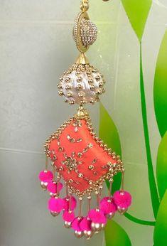 tassel with pink balls Saree Tassels Designs, Saree Kuchu Designs, Bridal Blouse Designs, Blouse Neck Designs, Rakhi Design, Christian Dior, Diwali Craft, Passementerie, Feather Design