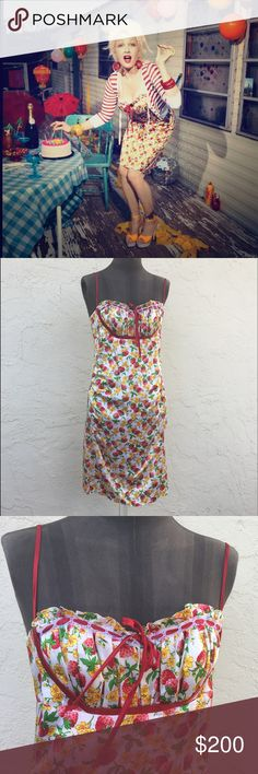 BETSEY JOHNSON strawberry print balconet dress Adorable adjustable spaghetti ribbon strap strawberry print 100% silk dress with balconet neckline and tie back with zip. Pure BETSEY JOHNSON magic worn by Cyndi Lauper for the BETSEY retrospective shoot circa 2008. This dress is in incredible shape and fits loosely on my size 8 mannequin. Rouching at side Sean's for feminine touch. Betsey Johnson Dresses