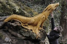 """North Yorkshire, mysterious artist carves amazing pieces out of trees, turning them into a dragon, kingfisher, and a """"ghostly figure"""" that looks kind of Green Man-ish to me."""