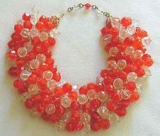 Coppola e Toppo multi-layered bib in a mix of glass and plastic faceted orange, clear and hot pink beads. Made for Emilio Pucci in the 1960s.