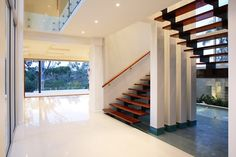 Internal stairs with water feature! by project designs architects www.projectdesignsarchitects.com.au