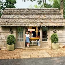 Cedar shingles. Pea gravel, stone patio and planters.