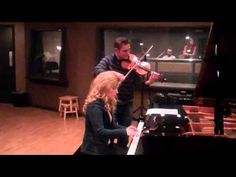 Erin Bates and Andy Leftwich in the recording studio (They're recording When the Saints Go Marching In)