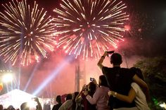 People look at fireworks during a New Year Celebration in Manila on Jan. 1, 2015. The Philippines is mainly Roman Catholic but the celebrations draw on ancient superstitions and Chinese traditions in which the noise from firecrackers is meant to drive away evil spirits and bring good luck in the coming year. Philippine authorities said more than 260 people had been injured by fireworks, firecrackers or stray bullets in the days leading up to New Year's Eve.