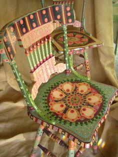 I'm going to have to go garage saleing for some old… Gorgeous painted chairs! I'm going to have to go garage saleing for some old chairs and try this myself! Hand Painted Chairs, Funky Painted Furniture, Colorful Furniture, Paint Furniture, Repurposed Furniture, Furniture Makeover, Cool Furniture, Painted Tables, Decoupage Furniture