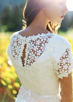Modest crochet lace wedding dress with short sleeves and keyhole back. TBarton Photography