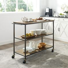 The modern industrial look and feel of the Brooke Kitchen Cart from Crosley Furniture makes this the perfect addition to your kitchen. Open shelving and an expansive top give you space to entertain, prep food, and much more. Rolling Kitchen Cart, Oak Beds, Prep Kitchen, Kitchen Ideas, Primitive Kitchen, Shabby Chic Kitchen, Open Shelving, Metal Shelves, Wood And Metal