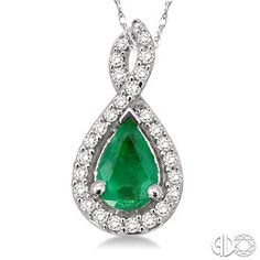 Styled in glistening 14 karat white gold, this beautiful tear drop designed pendant showcases a centrally staged pear shape emerald embellished by 27 prong set round cut accented diamonds and dangles beautifully from a rope chain.  #Emerald #Diamond #Pendant #SwansonsDiamondCenter