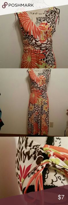 Maxi Dress Pretty maxi dress in fun print and good used condition. Cute tie accents at shoulders and gathered waistline makes this a very flattering dress. I can't find a brand tag on this so I'm pricing it low. Dresses Maxi