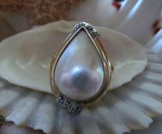Mabe Pearl Ring with Diamonds 10k Gold Size 8, to purchase double click on picture.