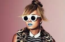 Love the hair, the sunshades, the blue lips, like a Regina Specktor's song