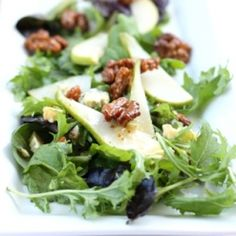 Blue cheese and pear salad with honey roasted walnuts and a honey mustard white wine vinaigrette. A sexy little summer salad.
