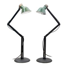 USA  1940's  Pair of articulated industrial floor lamps by the Save Lamp Company Baltimore, MD.