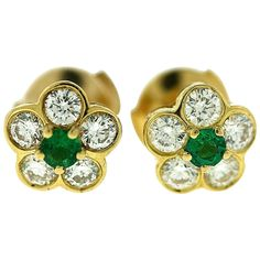 Van Cleef & Arpels Emerald Diamond Gold Floral Motif Earrings | From a unique collection of vintage stud earrings at https://www.1stdibs.com/jewelry/earrings/stud-earrings/
