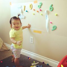 Want to get your LO to practice standing and cruising without them ever knowing? Do you want an activity that will keep her entertained for a long time? What you need: Contact paper from Target for $5.99 (tape the sticky side up), and... anything to interest that will stick to the wall!  #playingwithchanel