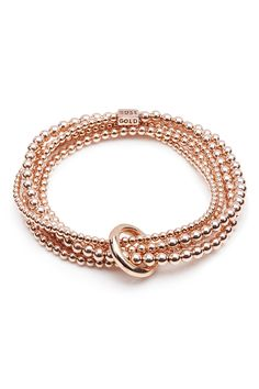 Sophisticated and stylish, this design is also available in gold bonded or sterling silver beads. It comprises a continuous, unbroken yard of graduated 14ct Rose gold bonded beads in a wrap style with a heavy binding ring to give it that iconic stack look. This hand-beaded bracelet sits beautifully on the wrist and can be worn alone as a signature piece and is also wonderful when layered or used as part of a larger ANNIE HAAK stack.