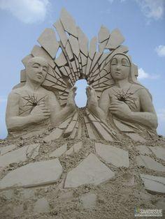 Symbolic?!! Let the light shine thru, n both broken at the heart center Sandissue ... sand sculpture ... sand art