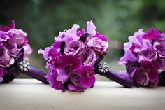 Purple Bridesmaid Bouquets    Photography: Darin Fong Photography   Read More:  http://www.insideweddings.com/weddings/outdoor-ceremony-purple-and-white-ballroom-reception/372/
