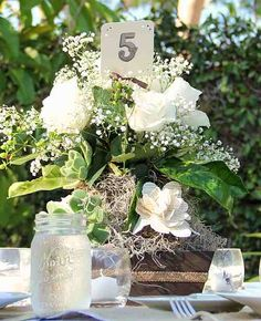 Centerpiece. Rustic chic. Roses, succulents and paper flowers.
