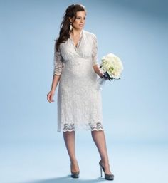 "Luxe Lace Wedding Dress - $275  Say ""I do"" to a stylish and modern wedding dress. Based off of our best selling 3/4 Sleeved Scalloped Boudoir Lace Dress, this ivory version is picture perfect for your wedding day. Soft ivory scalloped lace skims your body and hugs your curves to give you a beautiful hour glass figure."