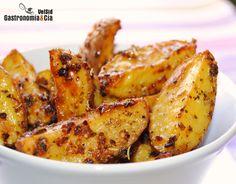 Gajos de patatas asadas picantes