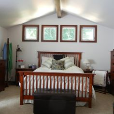 See how these homeowners transformed the large space above their garage into a master bedroom with a walk-in closet, ensuite bathroom and sitting area with a fireplace.| thisoldhouse.com/yourTOH